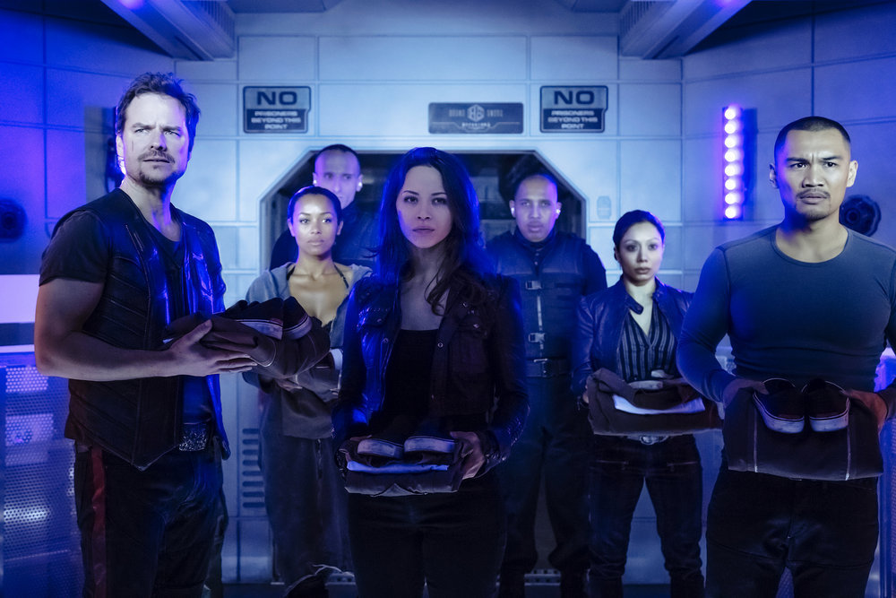 "DARK MATTER -- ""Welcome To Your New Home"" Episode 201 -- Pictured:  (l-r) Anthony Lemke as Three, Melanie Liburd as Nyx, Melissa O'Neil as Two, Alex Mallari Jr. as Four -- (Photo by: Jan Thijs/Prodigy Pictures/Syfy)"